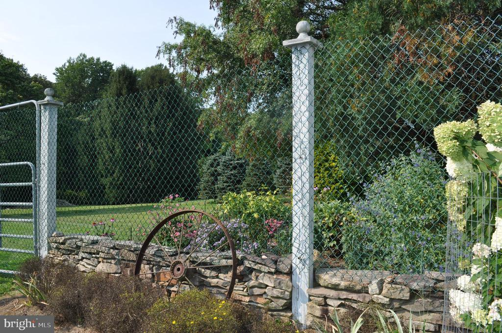 Stone walls highlight the grounds - 11690 FREDERICK RD, ELLICOTT CITY