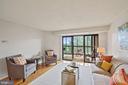 Living area with sunroom - 1600 N OAK ST #525, ARLINGTON