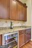 Butlers Pantry with Wine Fridge and Sink - 19186 CHARANDY DR, LEESBURG