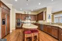 Gourmet Kitchen with Stainless Steel Appliances - 19186 CHARANDY DR, LEESBURG