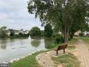 Walking path surrounds Lake Devereux - 7157 LAKE COVE DR, ALEXANDRIA