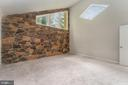 Primary Bedroom w/Stone Wall & Angular Window - 107 NINA CV, STAFFORD