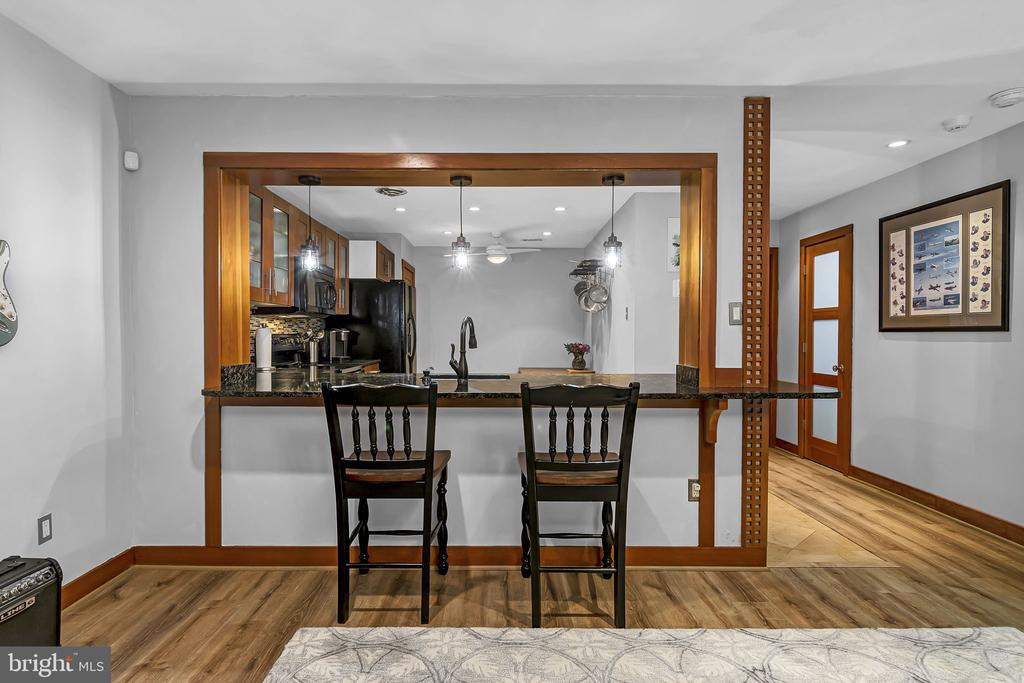 The living room opens to the kitchen - 1733 S HAYES ST #A-1, ARLINGTON
