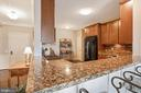 Kitchen - Lovely Raised Cabinetry w/ Crown Molding - 20505 LITTLE CREEK TER #302, ASHBURN