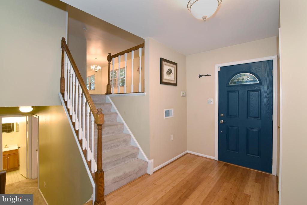 Entry with bamboo floor - 12818 FANTASIA DR, HERNDON