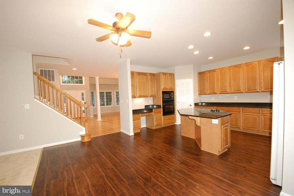 Kitchen brand new Luxury vinyl plank floor - 8599 EASTERN MORNING RUN, LAUREL