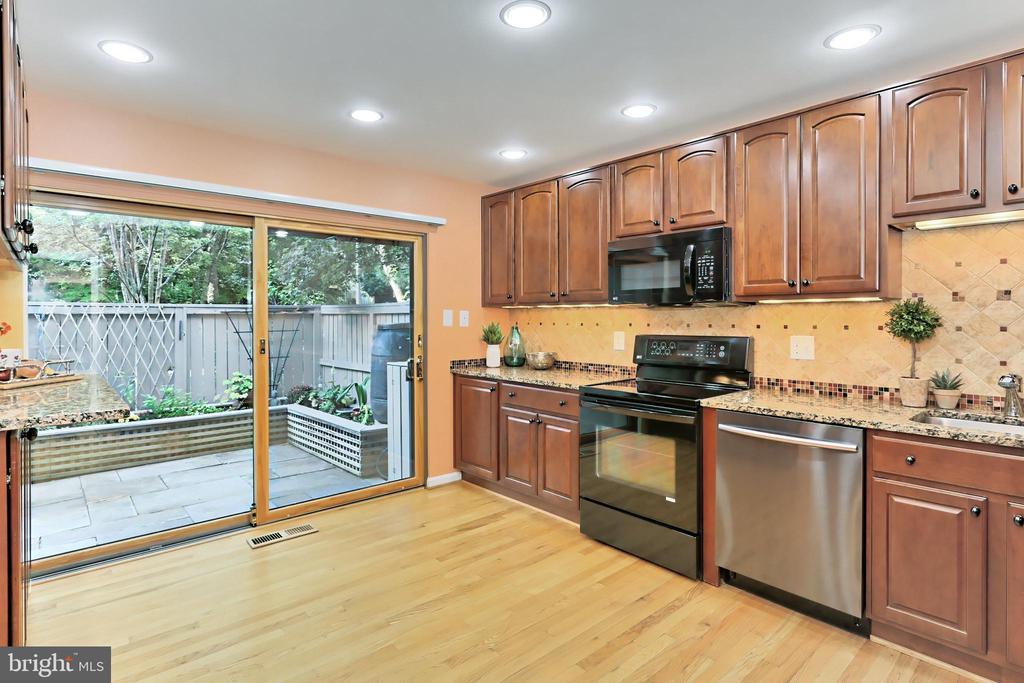 New Anderson sliding door to private patio - 11704 NEWBRIDGE CT, RESTON