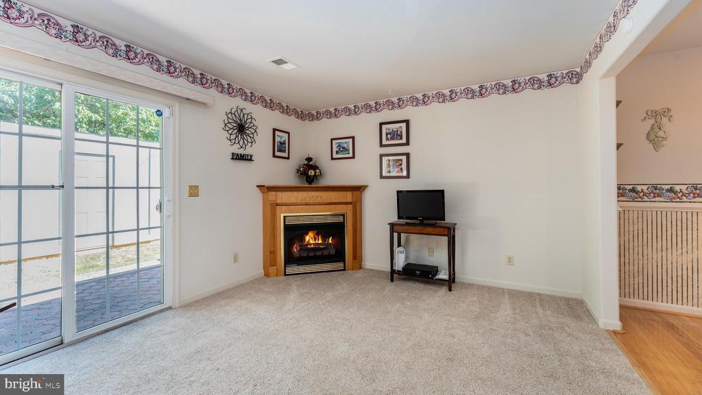 Family rm - cozy gas fireplace; doorway to kitchen - 9835 PLAZA VIEW WAY, FREDERICKSBURG