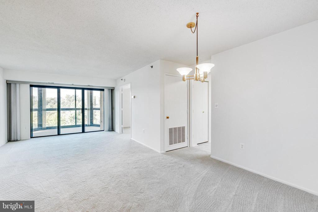 View from entrance foyer of dining and living area - 3330 N LEISURE WORLD BLVD #5-518, SILVER SPRING