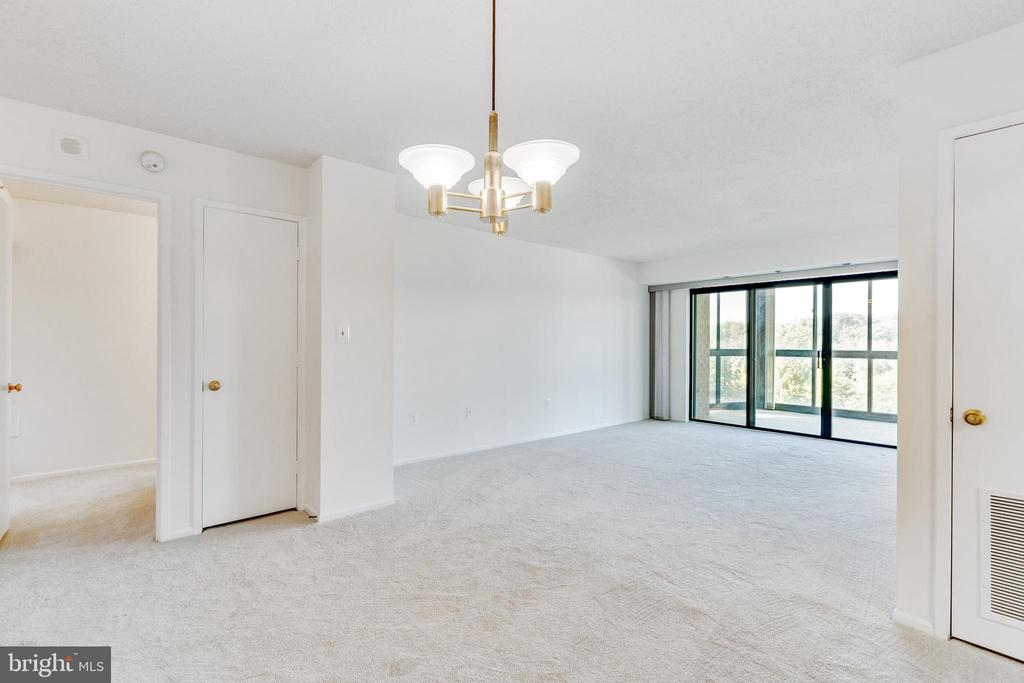 View from dining area towards living room - 3330 N LEISURE WORLD BLVD #5-518, SILVER SPRING