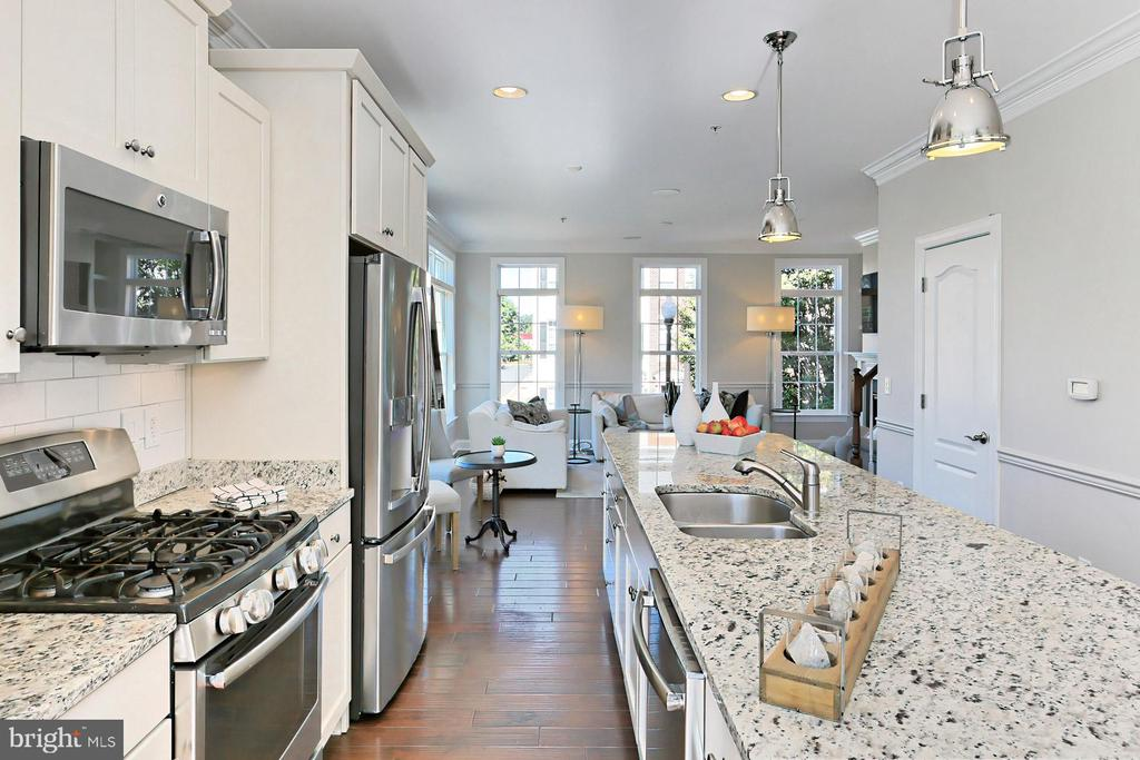 Cook's kitchen is open to living and dining areas - 4348 4TH N, ARLINGTON