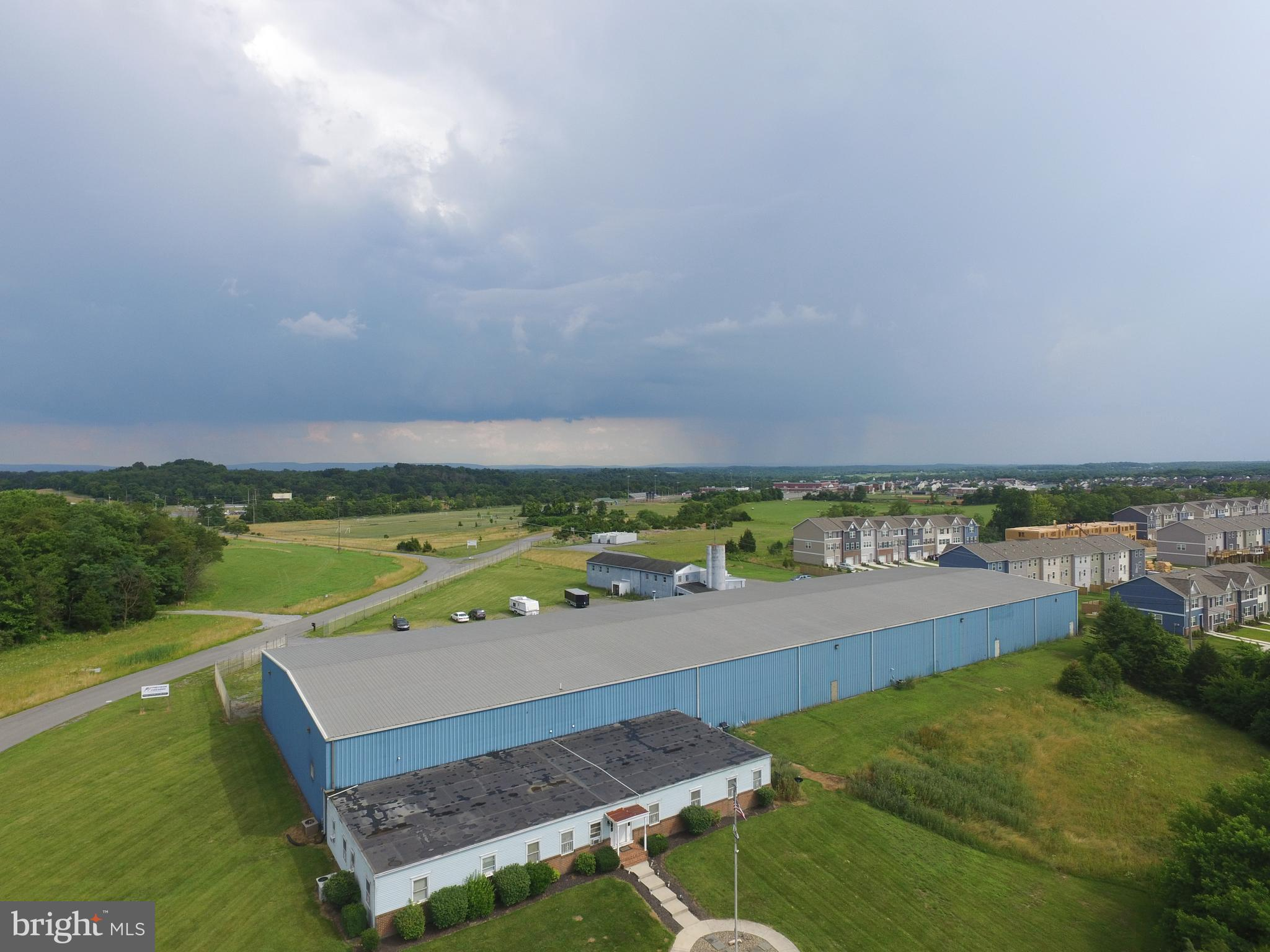 Total of 49000sqft in the complex -- 4k sqft office area with 12 offices and conference room, 35000sqft in the main building -- presently divided into 3 units and 10000sqft of additional office/retail space in a separate, detached building.  Great access to I81 and I70 in a rapidly growing commercial area.