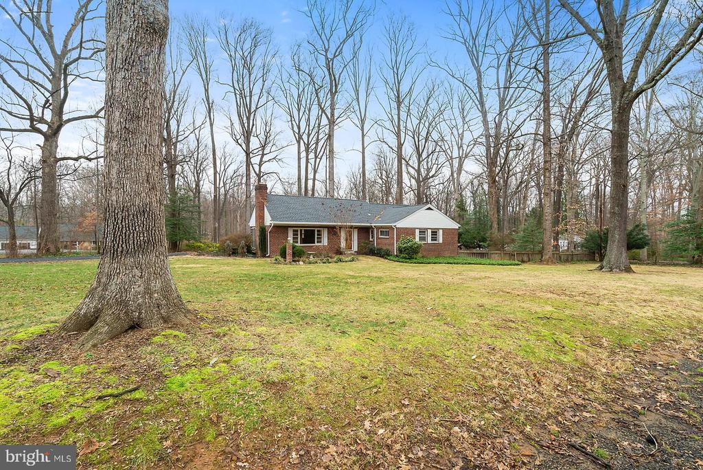 """Great opportunity to build your New Home or remodel/renovate the existing 2-Level Rambler. .73 Acre corner lot in the """"Custom Home"""" community of Brook Hills Estates. Many upper bracket new construction homes in this """"non subdivision"""" neighborhood of .5 ac to 6.0 ac home-sites. This home sits on the corner of two """"cul-de-sacs"""" with no cut through traffic. Flat lot with a few large trees and surrounded by custom homes. R-1 Zoning means only one home per lot, which ensures privacy. Current home needs significant work but is livable. Currently hooked up to Underground Elec, Public Water and Sewer. Natural Gas is currently active on the lot diagonally across the street. This is one of the few large acre (R1) communities still available inside """"The Beltway"""". The commute is fantastic, one traffic Light to I-395, I-495 and easy access to the Express Lanes on both I-395 and I-495! Tysons, The Mosaic District & Amazon's New HDQRTS are all within a few miles of this great community. Custom Home Builder available to discuss your renovation or custom build options."""