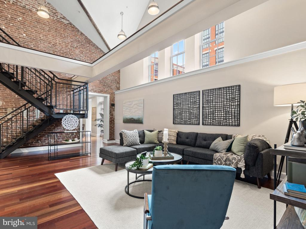 New Price! Welcome home to  City Living at it's best! Historic Landmark Lofts is a premier restoration and conversion of a 130 year-old historic building by Abdo Development. A boutique condominium which is one of just 44 one-of-a-kind luxury residences. This stunning two-story condominium boasts 2,827 square feet of living space. High ceilings and large windows light up the family room and it's overlooking loft.  The kitchen is fit for a chef with top of the line Subzero and Wolf appliances and plenty of seating for spectators both in the dining area and the large island.  Beautiful hardwood floors throughout create the perfect flow to the outdoors where city views await from two private decks and a balcony. The second level loft features a wet bar and a dramatic beamed ceiling which is accentuated perfectly with track lighting.  The owners suite is the height of luxury with an enormous walk in closet you just have to see to believe!  You won't be disappointed with the spa-like owners bathroom complete with huge shower and enormous stand alone clawfoot tub.  There are numerous amenities such as 24-hour concierge desk, a fitness room, party room with a kitchen, bar and pool table, theatre room and a roof top pool with grills and seating. You'll never want to leave but it if you do, you're just steps away from all the conveniences. Giant Foods is across the street and Whole Foods is just two blocks away.  Countless dining and shopping options just outside your door and short walks to metro stations at Union Station and New York Ave. Unquestionably the premier Capitol Hill location! This home is available to tour in person safely in compliance with current guidelines and personal virtual zoom tours are available by appointment . Check our the Virtual Tour at www.landmarklofts402.com