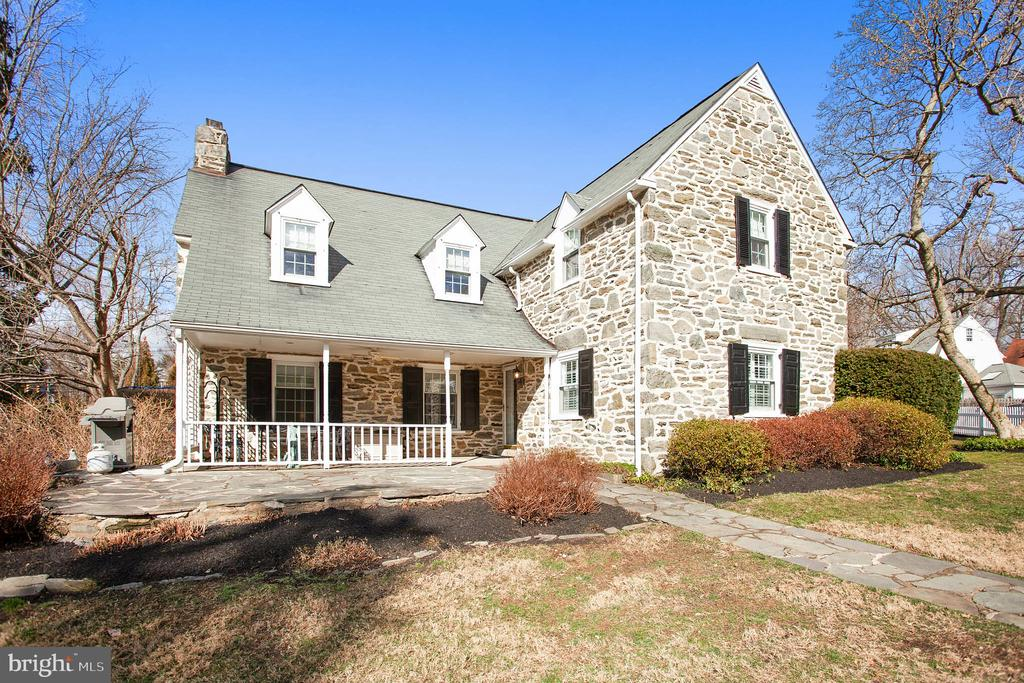 Most desired stone colonial  for sale in Radnor Township perched on a slight rise offering privacy, walkability and convenience. Old world charm of a Wallace and Warner home married with the modern updates of today, this 4 Bedroom 3.5 Bath home is bathed in natural light and bursting with character. Greeted by a wooden picket fence and graced with a flagstone walkway leading to a covered porch, enter a well loved and maintained home that contains a step down Living Room, charming Dining Room with built in corner cupboards, renovated eat-in Kitchen with granite, SS appliances, breakfast bar nook including a side entrance with expansion possibilities. Ascend to the 2nd floor by way of a gracious landing and find a large Master retreat with custom closets and a new spa like Master Bath with double headed shower. 3 additional Bedrooms are found on this level with 2 Full Baths. 1 of these Bedrooms could be used as an office. Lower level contains a full Basement housing Laundry, Recreation Room, storage and utilities. Storage Shed on side of house for gardening, yard tools and extra equipment. Other special items: Award-winning Radnor schools, 1 car garage with heat and covered side entrance to home, Newer A/C,  back stairs to Kitchen, invisible fence, tucked away on a 1-way 5 home street, the ability to walk to either type of train: Septa rail or high speed Trolley, as well as walkability to Bryn Mawr town, shops, restaurants and take advantage of all that Villanova University has to offer, such as its new restaurant, coffee house and soon to open new Drama Center. Truly a wonderful home in a tremendously special location!