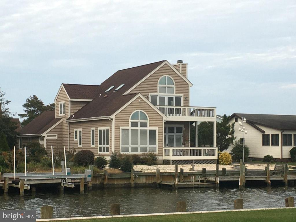 Stunning 90 degree Water views from living Areas and Master Bedroom. Located at mouth of canal gives easy access to open waters- Isle of Wight Bay . Lovingly kept as a 2nd home by original owners who custom built and updated over the years they enjoyed with their family and friends, Most of what you see comes with the purchase.