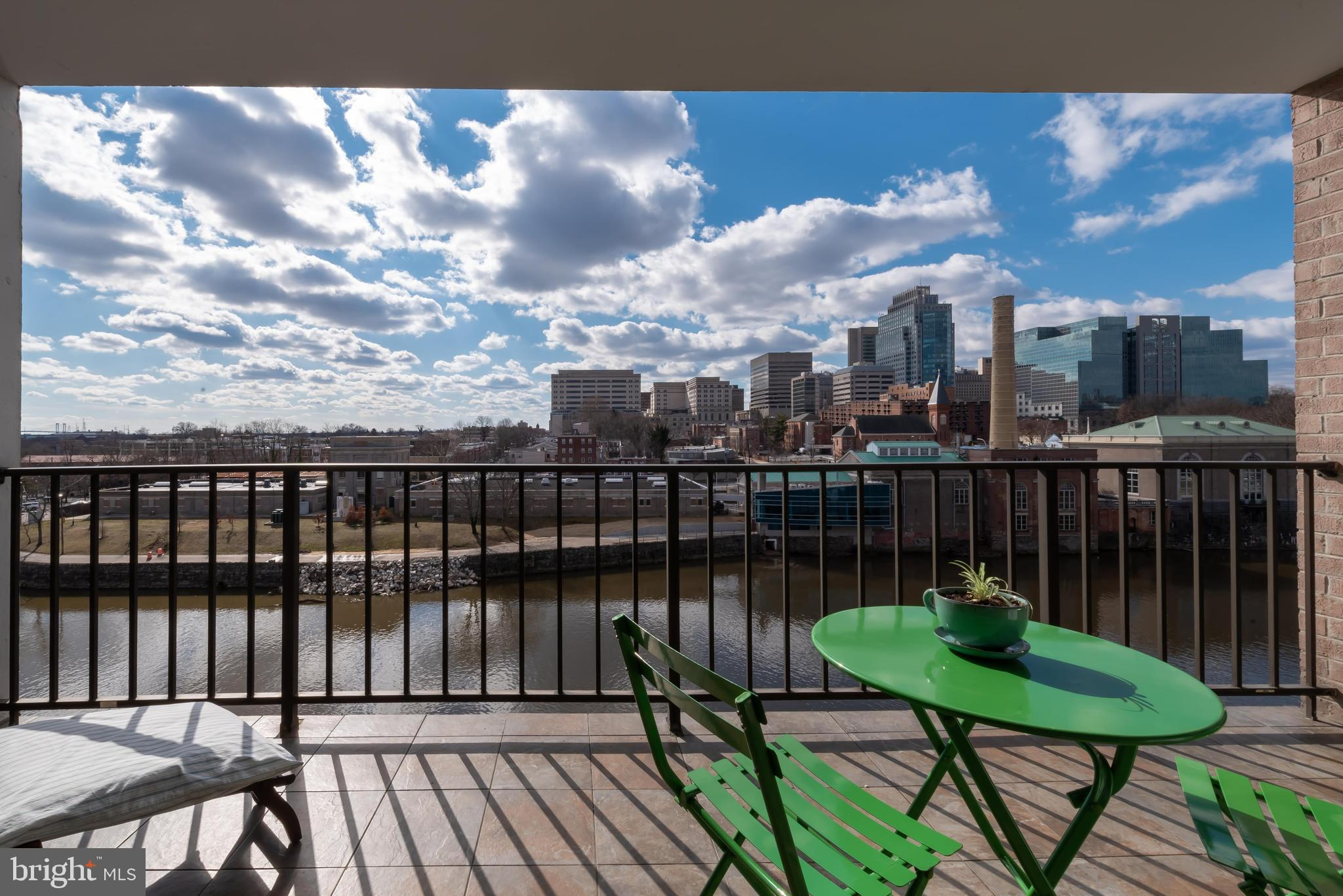 Location. Luxury. Lifestyle. Welcome to secured, private 1980 Superfine Lane Unit #503, 3 Bed/2.5 bath condo, where incredible panoramic Brandywine River views are the backdrop for everyday living. Surroundings are scenic! Take morning run along Brandywine River, relax on bench and read in park, walk the zoo, and appreciate fresh air and ever-changing scenery without picking up your car keys. Multiple civic groups bring vitality, involvement and revitalization to the area with exciting new projects. There are new-trend restaurants in the city and diverse entertainment downtown. Poised at the city edge, it's at your fingertips including mins. to I-95! Step inside to wide, warm and welcoming foyer with gorgeous slate floors, 2 roomy closets opposite each other creating balance, and views straight through to glass sliders on back wall leading to balcony and skyline. Appreciate 1-level, low-maintenance, circular floorplan, fluid, flexible living! PR to left aptly combines expansive mirror with angled natural-wood vanity/storage beneath, textured walls and soft up-lighting. Off foyer is dual-door, dual-entrance BR. However, with striking built-ins this room gets an automatic bid for library/office. Slate floors transition to polished hardwood floors, and large closet offers ample storage. From foyer, step into sweeping main flex space with stunning views, and where hardwood floors stretch out to glass sliders on far wall with extraordinary square footage in between. Embrace the space! Create conversation area with artfully-arranged couches, chairs and coffee table, with space along rooms perimeter for furnishings. Capitalize on extensive wall space with favorite prints or cherished portraits. Realize that space dimensions and purpose can be altered, as needs and lifestyle change. Nice architectural element here of built-in bookcase to showcase valued novels, prized possessions, or travel treasures. Floorplan wraps to DR with impressive space for table/chairs, which are p