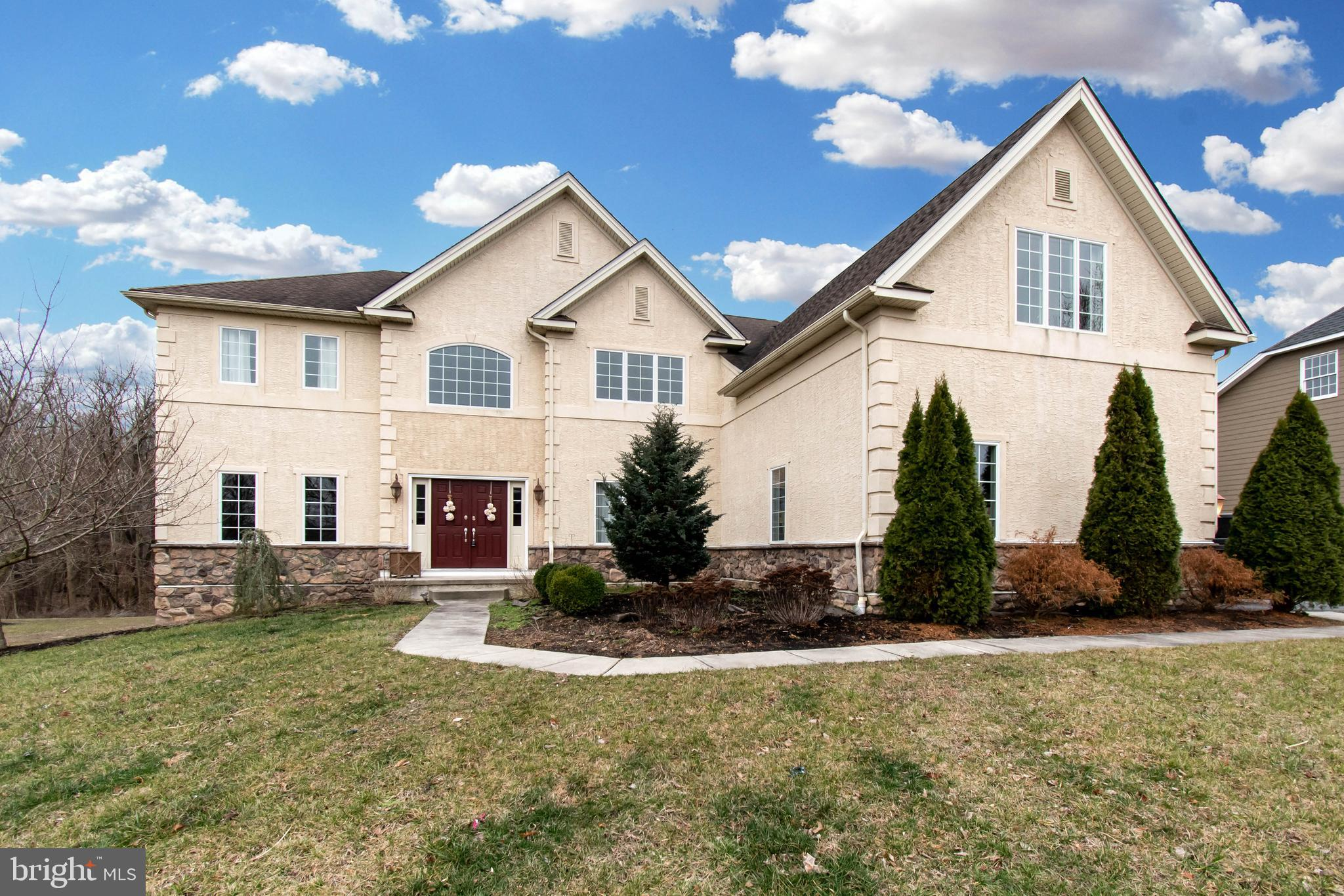 You must come and see this stunning home! Upon entering, you~ll see the beautiful curved staircase leading to 4 large bedrooms upstairs-the master with huge gorgeous tiled en-suite, 2 large closets; bedroom 2 also with its own bathroom, and 2 more spacious bedrooms. The upstairs hall has beautiful hardwood, overlooking the inviting family room. Downstairs offers beautiful new hardwood floors,  a very large eat-in gourmet kitchen with modern cabinets, granite countertops. On to the elegant and spacious dining room, warm family room with high ceilings and fireplace, comfortable study and inviting living room. The home also offers a full basement, huge yard and a deck perfect for lounging, entertaining, cookouts, or whatever you can imagine! Schedule your showing today!
