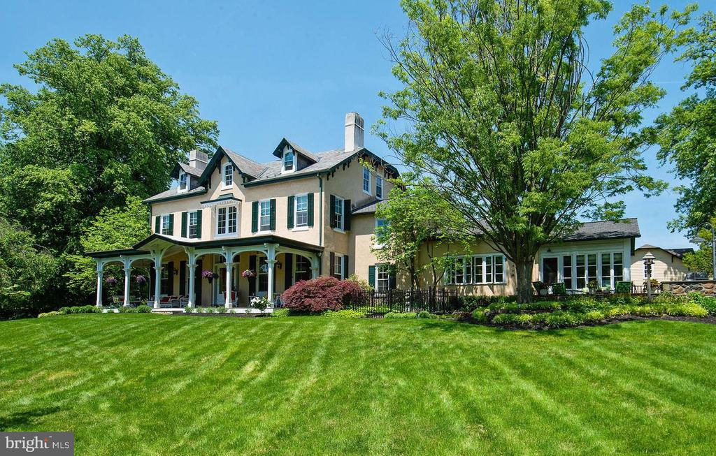 Newly updated and freshly staged.  An impressive 6-bedroom manor home offering modern luxury paired with a verdant 4+ acre lawn with independent stone carriage house, classic rectangular pool, deep mahogany covered porch and handsome stone pool house. Remarkable for its high ceilings and sunlit spaces, this 1900~s home is impeccably finished on all four levels, highlighted by new designer light fixtures throughout, refinished floors, newly carpeted, and freshly painted walls that perfectly accent the inviting spaces. A front to back Foyer connects the arrival courtyard to the rear of property and beyond to a flat yard and pool. Wide plank original flooring pairs beautifully with freshly painted, hand applied plaster walls, deep crown and base molding with most rooms warmed by wood burning fireplaces. The formal rooms, Living, Dining and Library flow from the center Foyer while a spacious Butler~s Pantry provides exceptional storage and utility and connects the formal areas to the home Family spaces. A den, incredible Kitchen with 12+ foot vaulted ceilings and large Breakfast area, all with French door access to the covered porch and unending views of the gardens and centennial trees.  Ascend the front sweeping staircase, (or travel on the all floor elevator) to beautifully detailed Master Suite. Brightened by its southern exposure with added charm from the gas fireplace, the master suite simply sparkles. An immense outfitted closet and dramatic step-down master bath with radiantly heated floors, an oversized shower and marble vanities offers a true end of day retreat. Two additional bedrooms and a large bath are also found on this level, while the third floor offers two bedrooms each with their own baths. Accessed from the front of the home or by the home~s elevator, an independent bedroom, bath living area and utility kitchen provide unparalleled space for an au pair, long-term guest or multi-generational living.  Truly a home for the ages. This home offers a tradi