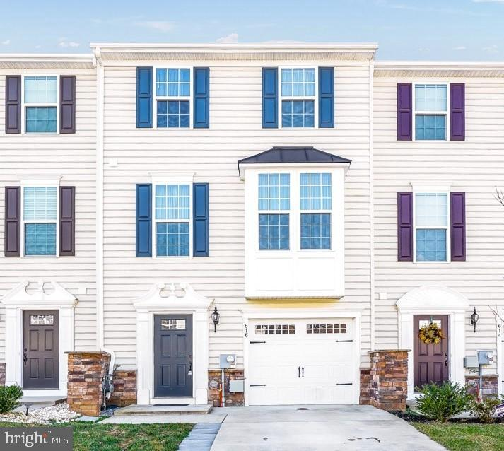 HIGH HOOK FARMS - Beautifully kept 4 bedroom / 3.5 bath townhouse within the APPOQUINIMINK SCHOOL DISTRICT.  This lovely home boasts 3 FLOORS OF LIVING SPACE, a GARAGE, and so much more - it must be seen!  Enter into the first-floor foyer and straight ahead you will find an entry-level bedroom with walk-out access to the back yard, a WALK-IN CLOSET, & a full bathroom.  Head up to the main level of the home where you will find the living room, kitchen, and dining areas.  The huge kitchen features; STAINLESS STEEL APPLIANCES, GRANITE countertops, recessed lighting, a pantry, and an oversized island.  Sliding glass doors from the dining area lead directly to the elevated deck which is ideal for outdoor dining & entertaining!  Also on the main level you will find a powder room & plenty of natural sunlight.  Head to the upper level where you have 3 additional bedrooms and 2 full baths.  The master suite features a tray ceiling, WALK-IN CLOSET, & a 5-PIECE MASTER BATHROOM.  The master bathroom includes double sinks, a stall shower, and a soaking tub surrounded by white tile.  This home even has a 2ND FLOOR LAUNDRY closet - talk about convenience!  Other notable features include; epoxy flooring in garage, builder bump outs added in kitchen & master bedroom, & ALL APPLIANCES INCLUDED.  This home is CONVENIENTLY LOCATED just minutes from major roadways, Route 1 & Route 13.  Don't wait, call to schedule your tour today!