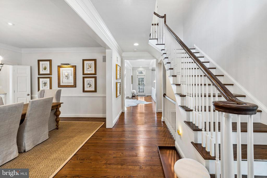 """Welcome Home to this magnificent Colonial, perfectly nestled in the heart of Bryn Mawr andaward-winning Radnor School District! This spacious and elegant home features masterfuldesign, modern flow, and traditional luxury. You'll be instantly swept away by large sun-filledrooms, 9' ceilings, on-site finished oak floors, crown molding, and chic chandeliers and sconcesby upscale designer brand, Visual Comfort. Easy living begins when you enter the center hallfoyer, open to both Formal Living and Dining Rooms. The formal dining room with traditionalwainscoting and adjoining Butler's Pantry is perfect for any event. The foyer continues to anamazing Family Room with gas fireplace adorned with wood-paneled mantle, built-inbookshelves, and beamed ceiling. The family room window wall leads to the Trek Deck with16'x13' Perfecta Motorized Retractable Awning and Weber Gas Grill, making Indoor-OutdoorLiving a reality. The Gourmet Kitchen is fabulous with an Over-Sized Island, Wolfe 48 """"Cooktopwith 6-burners / grill and unique Chef's Window, Sub Zero built-in Fridge / Freezer, Bosch DoubleWall Ovens, Bosch Dishwasher and convenient built-in Microwave Drawer. The kitchen boastsplenty of soft-close cabinets and dovetail drawers for ideal organization, like pull-out shelves andnatural maple cutlery inserts. The Custom Pantry is complete for optimal storage with soft-closepull-out shelves, bins, and wine storage rack. Enjoy more casual dining in the tranquil MorningRoom, surrounded by 3 window walls and trees! The Oversized 2-Car Garage features customStorage Racking System, 8~ Built-In Storage Cabinet, and Built-In Work Bench to organize all yourhobbies, polyaspartic finished flooring (better than epoxy!), Hunter Douglas shutters, andelectronic keypad. With Custom Bench Seat and Cubbies, Built-In Desk, Custom Entry Closet, andPowder Room, the Mudroom can easily keep the family organized. A Private Staircase leads to aGuest Bedroom with en-suite and 2 closets. The Master Bedroom Retr"""