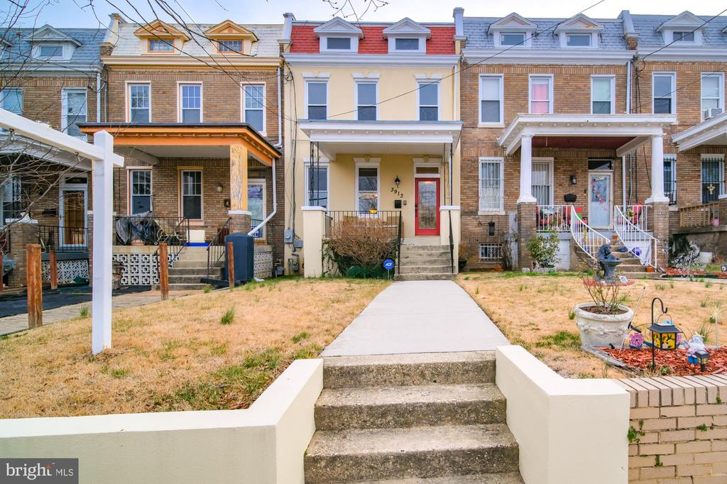 This spectacular home is one of the LARGER row homes located on a quiet street in the Hot Petworth neighborhood! Three levels include three bedrooms, three full baths, and one-half bath. The main level has a nice open concept with a large dining area.  The kitchen offers high-end stainless steel appliances, granite countertops, and island with bar seating. Private fenced backyard  off the kitchen has a tiered deck- lower grilling area and upper space to entertain.  Exposed brick wall leads to the second level. The LARGE master includes a sitting area, Juliet balcony, and en-suite with jacuzzi tub.  There are two additional nice size rooms. Basement  includes an entertainment area, wet bar, full bathroom, laundry space, and private rear entrance.  BONUS: Oversized CAR GARAGE and large attic space for additional storage!  HOME WARRANTY included. Minutes away from, Safeway, Starbucks, Yes Organic Market, Capitol Cider House, restaurants, bars, Downtown, and more.  A short walk to Georgia Ave-Petworth station.  This is your next home!  Take a Virtual Tour: https://www.youtube.com/watch?v=5loZdqpbmik#action=share