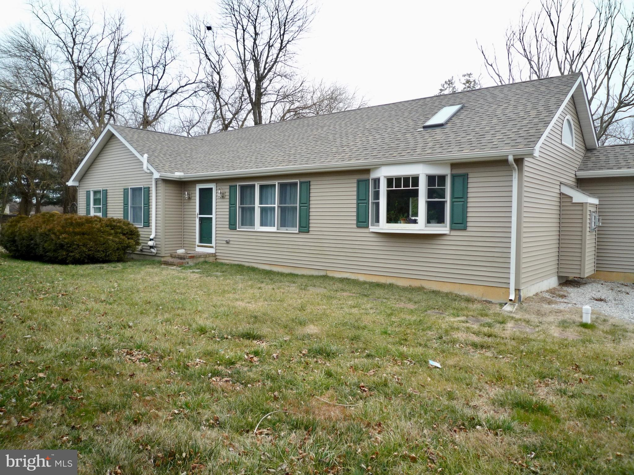 Priced $10,000 below appraised value on 3/3/20 (Full appraisal available on MLS).  This well maintained & updated 4Br/2.5 Ba Ranch home is ready for its new owner!  New Architectural Roof in 2016 and maintenance free vinyl siding adds peace of mind to minimal future exterior maintenance costs!  Entry at the front door opens to the home's Dining Room with open views of the Kitchen and new Living Room addition just completed in 2016! Updated Laminate flooring runs seamlessly between the Dining Room & Kitchen.  Fresh neutral paint & great natural light throughout! The Kitchen features plenty of cabinet storage, updated granite counters, extra counter & deep 6-drawer cabinet storage were added along the open wall  providing loads of additional storage & countertop space!  Convenient sliding doors lead out the the deck overlooking the backyard.  The main focal point of this main floor layout is the amazing Living Room addition just completed in 2016!  This 25x16 room (with split system heat/air control) boasts tons of light & space featuring cathedral ceiling with sky lights, a bay window, ceiling fan, neutral plush carpet, custom gas fireplace with stone surround & chunky reclaimed wood mantel and a unique display shelf across the length of the room w/ crown molding decor!  The convenient main floor Laundry Room is just off the Living Room. Moving back to the Bedrooms on the main floor, there is a good sized Master Bedroom featuring double closet storage, ceiling fan, neutral carpet & a private Master Bathroom offering vinyl flooring, stall shower & vanity sink.  The 2nd main floor bedroom is also neutral & offers ceiling fan and double closet storage with easy access the the full bath in the hallway.  Downstairs you will find loads of additional living space starting with 2 large open finished areas that create a great Family Room space for both day to day or entertaining! There are 2 additional bedrooms and a convenient power room in the lower level as well!  Conveniently located near major routes 13/1 & 72 offering an easy commute to loads of shopping, dining & entertainment options! Just minutes to the Christiana Mall and Christiana Hospital as well as historic town of St George's , Delaware City & the Fort DuPont State Park overlooking the Delaware River!  Put this great home on your next tour!  See it!  Love it!  Buy it!