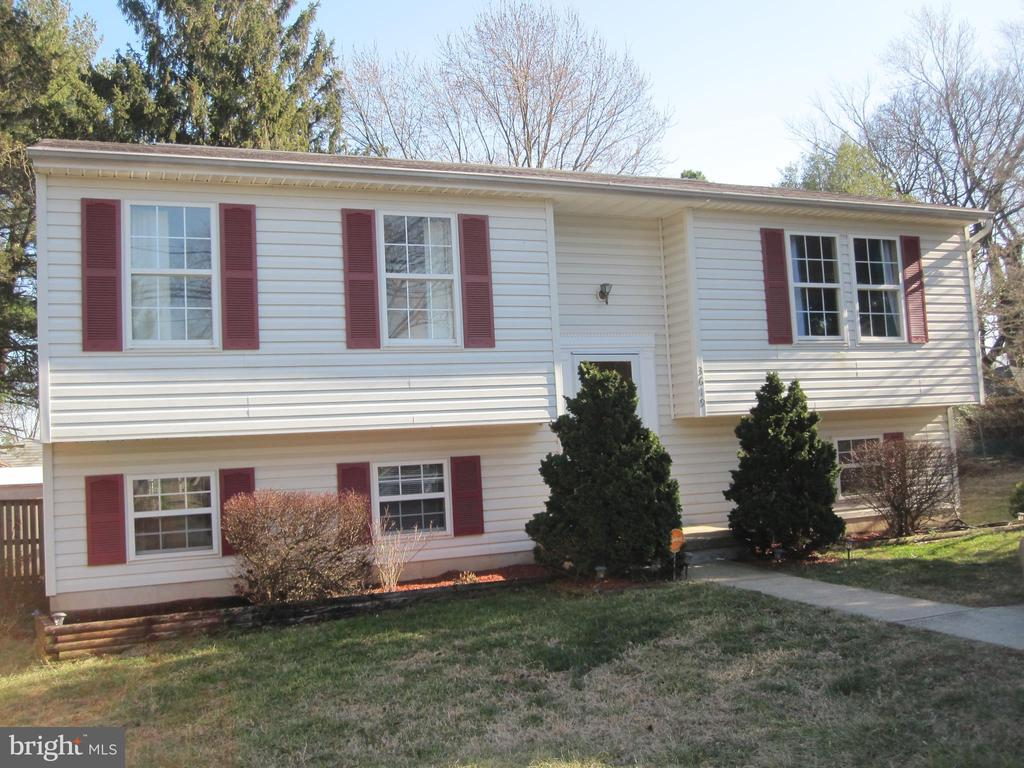 Beautiful Single Family Split Foyer Home that features a open contemporary floor plan.  Freshly painted, with new kitchen cabinets and premium counter tops.  New carpet throughout the home providing a warmth and coziness after a long day....Spacious deck overlooks expansive fenced in back yard for spring and summertime fun!