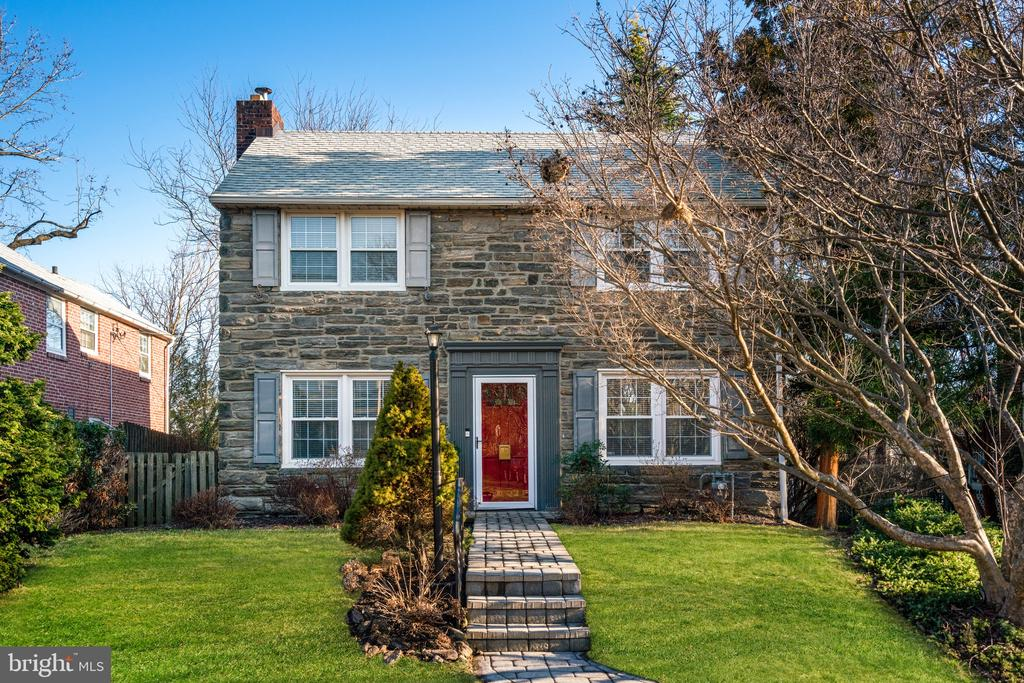 EXTREMELY RARE OPPORTUNITY to own a RENOVATED, TURN-KEY 1940's STONE COLONIAL in the highly sought after PENN WYNNE section of Wynnewood - LOWER MERION TOWNSHIP! This Classic 1940's Main Line Stone Colonial w/ DRIVEWAY & 1 CAR GARAGE is perfectly nestled on a beautifully landscaped lot w/ Private Fenced Yard with great Entertaining Deck in one of Wynnewood's most desired locations ~ just steps to the Nationally-recognized Blue Ribbon School of Excellence Penn Wynne Elementary, Parks, Transportation, Restaurants & Shopping.  This impeccable 3 Bedroom 2 Full Bath home offers Character & Details of a By-Gone-Era, Modern Amenities & ABSOLUTE MOVE-IN CONDITION +  LARGE FIRST FLOOR FAMILY ROOM.  This pristine home has SO MUCH TO OFFER from the beautiful Stone facade, to the specimen plantings & Paver Walkway to the MANY NEW UPDATES & ABSOLUTE MOVE-IN CONDITION.  Step inside and marvel at the Sun-Drenched Interior, Gleaming Hardwood Floors & GREAT OPEN-CONCEPT FLOOR PLAN.  Large Living Room w/ Recessed Lighting & Wood Burning Fireplace, Sun-Drenched Dining Room w/ Two Walls of Windows OPEN TO NEWLY RENOVATED KITCHEN w/ Crisp White Cabinetry, Quartz Counter tops, Glass Subway Tiled Back-splash, Designer Lighting & Stainless Steel Appliances including 5 Burner Gas Range,  Dishwasher, Convection Microwave & Deep Stainless Sink which is OPEN to the AMAZING FAMILY ROOM w/ Door to the Large Entertaining Deck & Private/Serene Fenced Yard (Perfect for Outdoor Entertaining). The 2nd Floor offers Large Master Bedroom + 2 Additional Large Bedrooms & Updated Vintage Tiled Full Hall Bath w/ Floor To Ceiling Tile, Pedestal Sink & Tub/Shower.  The Finished Walk-Out Lower Level offers Play/Media Room, Abundant Storage, Utilities, Full Laundry & FULL BATH w/ Ceramic Tile, Stall Shower & Pedestal Sink - the Basement Walk-out offers direct access to the Driveway & (1) Car Garage (ultra-convenient for coming in with groceries). Additional Features include: Newer~Roof (2015), Windows, High Efficiency Gas Furnace (2010), New Central Air (2017), New Water Heater (2017), Complete Kitchen Renovation (2016), Basement (2019), Freshly Painted, New Designer Lighting Fixtures, Beautiful Landscaping, Serene & Private Fenced Yard w/ Large Entertaining Deck, DRIVEWAY, 1 Car GARAGE, FINISHED BASEMENT & WALK TO Penn Wynne Elementary School, Restaurants, Shopping and Transportation.  TOP RATED LOWER MERION SCHOOLS & RARE-ABSOLUTE MOVE-IN-CONDITION make this PRISTINE HOME a RARE OPPORTUNITY NOT TO BE MISSED - DO NOT WAIT!!!