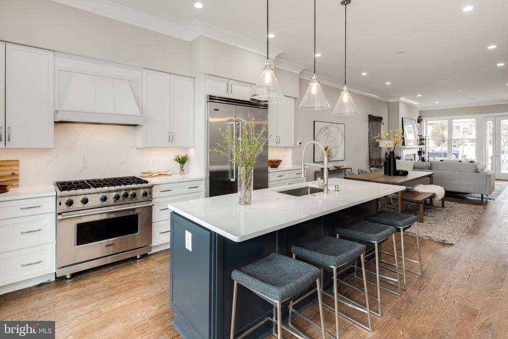 *** PRIVATE SHOWINGS AND/OR VIRTUAL SHOWINGS AVAILABLE BY REQUEST. Visit 3716 S street.com for 3D walk through tour. Completely transformed by Bogdan Builders in 2020, this newly renovated Burleith stunner features five bedrooms, five bathrooms, one powder room, and over 3,540 square feet. An open concept floor plan shines with 10~ ceilings, a gas fireplace, in-ceiling speakers, unobstructed northern-southern exposures that pass light through the space, and a large walk-out deck accessed off of the kitchen. An oversized chef kitchen features a large island, breakfast nook, professional Viking appliances, dual dishwashers and sinks, quartz surfaces, crisp white shaker cabinetry, and a dual zone wine refrigerator. The second and third floors each maintain a master suite with dual walk-in closets, private balconies and ensuite bathrooms with marble tile, dual vanities, marble, and glass surround showers. The additional bedrooms on the second and third floor also feature ensuite bathrooms and the second floor includes a laundry room. The lower level in-law suite contains an additional bedroom with a jack and jill bathroom, a second living space, a large wet bar, and a walk-out rear patio. The home is conditioned by a dual HVAC, is secured by a Nest x Yale smart deadbolt keypad, and contains secured off-street parking for two vehicles. The home is just minutes from numerous dining and shopping options in Georgetown and Glover Park, including a five minute drive to Trader Joes and the soon-to-be reopened Whole Foods.