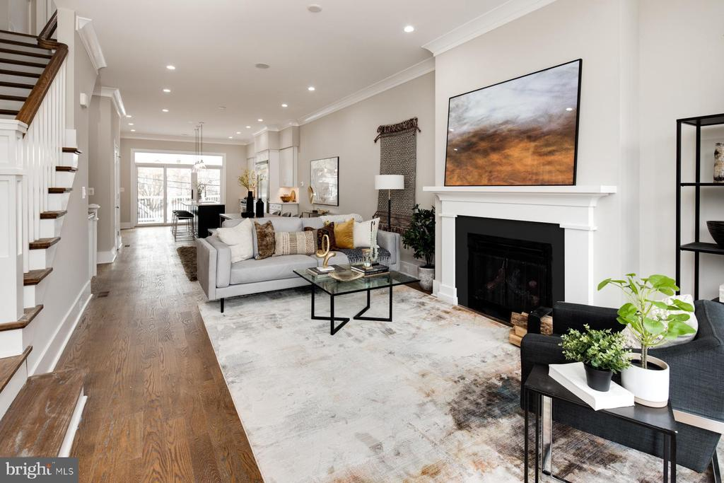 SHOWINGS BY APPT OR VIRTUAL SHOWINGS BY REQUEST. Visit 3716 S street .com for 3D walk through. Completely transformed by Bogdan Builders in 2019-2020, this newly renovated Burleith stunner features five bedrooms, five bathrooms, one powder room, and over 3,540 square feet. An open concept floor plan shines with 10~ ceilings, a gas fireplace, in-ceiling speakers, unobstructed northern-southern exposures that pass light through the space, and a large walk-out deck accessed off of the kitchen. An oversized chef kitchen features a large island, breakfast nook, professional Viking appliances, dual dishwashers and sinks, quartz surfaces, crisp white shaker cabinetry, and a dual zone wine refrigerator. The second and third floors each maintain a master suite with dual walk-in closets, private balconies and ensuite bathrooms with marble tile, dual vanities, marble, and glass surround showers. The additional bedrooms on the second and third floor also feature ensuite bathrooms and the second floor includes a laundry room. The lower level in-law suite contains an additional bedroom with a jack and jill bathroom, a second living space, a large wet bar, and a walk-out rear patio. The home is conditioned by a dual HVAC and contains secured off-street parking for two vehicles. The home is just minutes from numerous dining and shopping options in Georgetown and Glover Park, including a five minute drive to Trader Joes and the soon-to-be reopened Whole Foods.