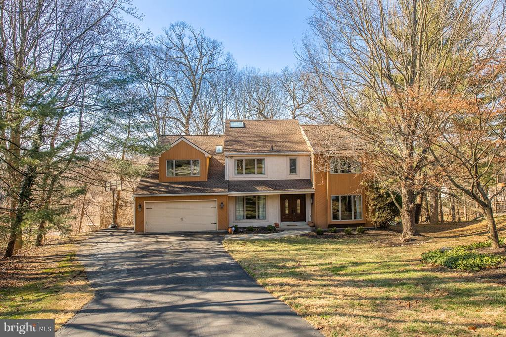 Beautifully updated, centrally located, desirable neighborhood and meticulously maintained -920 Honeysuckle Lane in Wynnewood has it all.  This 5 bedroom, 4 full bathroom, 1 powder room home with over 4,800 square feet of fabulous living space is located on a cul-de-sac in the sought-after neighborhood of Indian Creek. The etched glass, double door entry draws you into the home's foyer. The marble foyer is flanked by the living and dining rooms and spills into an open living space that reveals views of the grounds beyond. The living room has hardwood floors, large windows and flows to the family room. The dining room has a floor to ceiling window that over looks the front yard, hardwood floors and leads to the kitchen creating the perfect space to entertain. The eat-in kitchen includes granite counters, stainless steel appliances, a large pantry and overlooks the breakfast room. Windows that illuminate the room with natural light surround the breakfast room. Access the large deck through the sliding glass door in the breakfast room. The 2-story family room, which looks onto backyard & the beautiful Dogwood trees, has hardwood floors, a dry bar, and a beautiful stone fireplace that is the focal point of the family room and the perfect spot to curl up and read a book.  A first floor bedroom, with private ensuite bathroom is perfect for in-laws or an au pair. A powder room, coat closet, laundry room and access to the oversized 2-car garage complete the first floor. Ascend the stairs to the second story where you will find a large master bedroom suite with private balcony, an ensuite bathroom with Jacuzzi tub, glass enclosed shower and double vanity. A large master walk-in closet with a sun tunnel provides your dressing area with natural light. 3 spacious bedrooms, a kids den/study, linen closet and full hall bathroom with vanity and glass enclosed shower complete the second floor. The finished, walkout lower level has endless possibilities- it can be a recreation room, play room or in-home gym/office with a wall of built-in bookcases. A full bathroom and ample storage space round out the lower level. In 2017, the current owners installed a new roof, new windows, new hot water tank, creating a very energy efficient home.  920 Honeysuckle Lane is conveniently located close to everything ~ walking distance to the Merion and Narberth train stations, Whole Foods, Wynnewood Shopping Center, Suburban Square, parks, restaurants, shopping and much more! All this and located in award winning Lower Merion School District.  This home has easy access to public transportation, Center City and Philadelphia International Airport.