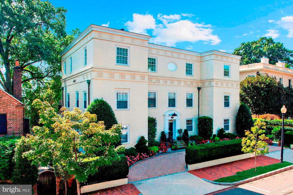 STUNNING GEORGETOWN OASIS! This fully-detached 5 bedroom, 6.5 bath estate sits on a 12,000 SF lot in the heart of historic Georgetown. The circular driveway and wide federal facade welcome you into four finished levels where no detail has been overlooked and every room is flooded with sunlight. From an open foyer with fireplace, living room, sun room, dining room, breakfast room and cocktail bar, to the double great room with fireplace, library, and family room, there is no shortage of incredible common spaces in which to live and entertain. This house also features the largest master suite in Georgetown complete with two master baths, a 29' walk-in closet, separate hair salon room, fireplace and windows on all sides. The enormous south-facing and sunny garden includes a full-size swimming pool, multiple entertaining terraces, professional landscaping and two-car garage. This one of a kind offering on a highly sought block offers the rare and perfect balance between luxury living and entertaining within the setting of beautiful historic Georgetown.