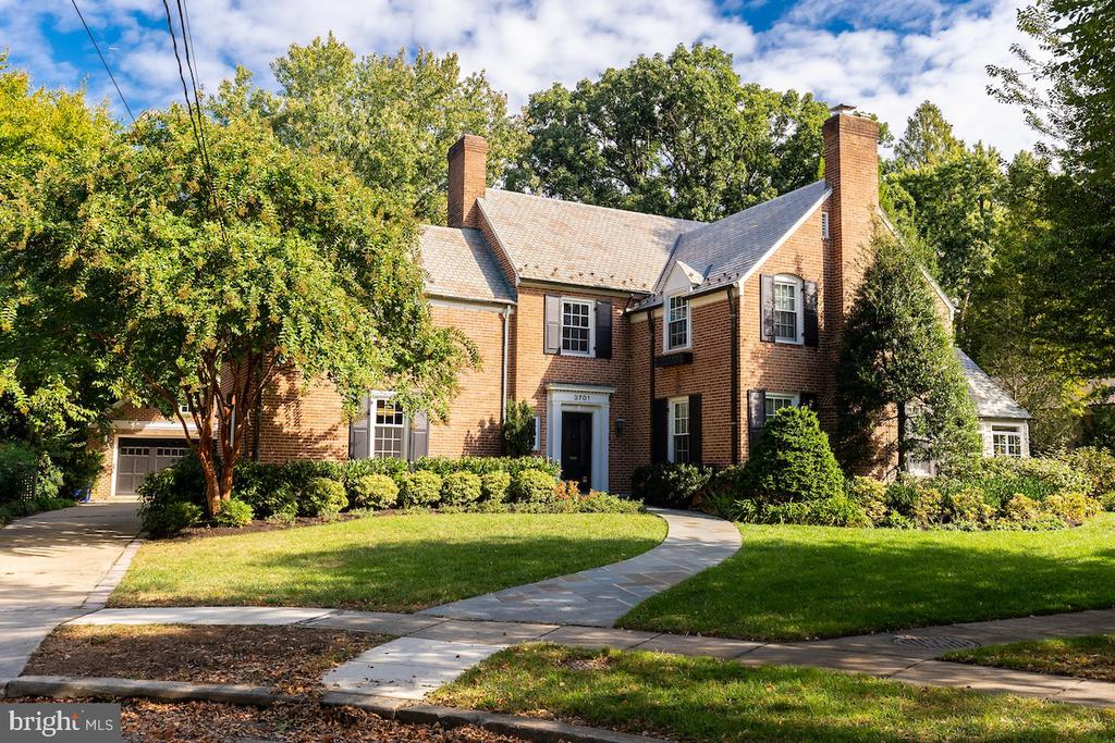 """Classic brick Chevy Chase home with slate roof, separate 2 car garage on a coveted cul-de-sac .Features include large eat-in chefs kitchen which can seat 12, along with a 36"""" wolf range and full size Bosch oven. Light pours in thru the 13 windows overlooking the 13,900. sq ft lot. Large family room with built in Mahogany bookcase. Dining room with French doors to flagstone patio. A large Living room with fireplace. A  stunning sun room off the living room that is separately zoned. Powder room and mudroom connected to both the front hall and back complete the 1st floor. Upstairs you'll find 4 bedroom 2 full baths ,hardwood floors throughout & 3rd floor suite includes bedroom ,full bath ,sitting area ,cedar closet and great storage. English basement with fireplace, laundry area and a vintage 1960's bomb shelter you must come to see."""