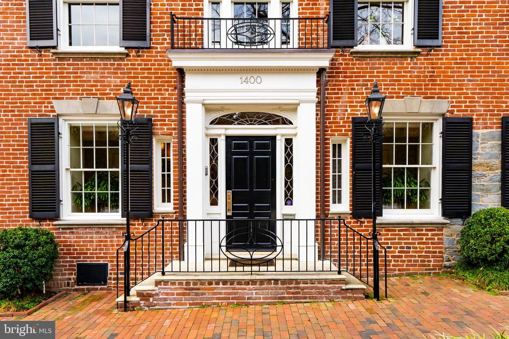 A prominent Georgetown West-Village residence originally constructed circa 1800, this distinguished Federal   showcases history, master craftsmanship, and every modern convenience. Home to John F. Kennedy, the property underwent a complete renovation led by renowned architect Richard Foster and preeminent builder Tom Glass. Every detail was considered to achieve unparalleled quality. This exceptional home with attached garage and spectacular rooftop viewing-terrace also features up-to-the-minute technology and mechanical systems including Lutron and Crestron. With proximity to Georgetown bustle from boutiques and restaurants to iconic monuments and regional airports, this storied residence is located on a picturesque cobblestone street, and surpasses comparison.