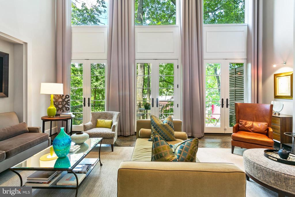 FOR OUR NEW GLIMPSE TOUR (GET A GLIMPSE INTO THE FABULOUS LIFESTYLE YOU COULD BE LIVING), VISIT:   https://poduslogroup.com/3087-ordway-street-nw/   ----Architectural vision meets design innovation! Behind this Federal-style facade boasts a five-story 4000 square foot contemporary masterpiece made for bespoke living. Custom finishes and unparalleled workmanship are thoughtfully executed on this four-bedroom, four-bathroom and two half bath home to create a sense of relaxed, modern luxury with a jet-setting refinement found in the world~s top hotels. The first two floors have exceptional proportions with open living and entertaining spaces. The two-story living room features a dramatic Haisa Blue Travertine limestone fireplace accentuated by 20-foot windows and matching sets of french doors opening to a private curved deck. Adjoining this room is a kitchenette with marble countertops and a Viking wine refrigerator. Separating the dramatic living room is a second story custom glass railing that provides a dramatic introduction into the dining room and kitchen. The European-styled kitchen is designed for culinary experts complete with Miele appliances, oversized waterfall island, quartz, and travertine limestone, Delta Light LED fixtures, coffee bar and decorative shelving which separates the eat-in kitchen from the formal dining room. The third floor features two spacious master suites with private en-suite bathrooms, double vanities, and walk-in closets. The top floor features a third bedroom with en-suite bathroom and recreation room/office that opens to a private rooftop terrace. The lower level is fully finished with a bedroom and en suite bathroom, laundry room and a media room with custom bookcases that (now not so) secretly open to a small wine cellar. This home is complete with an elevator, Wenge-stained oak hardwood floors, 2-zone HVAC, parking for 2 cars (driveway and garage). A fabulous location in quiet, yet convenient Cleveland Park with easy access to Co