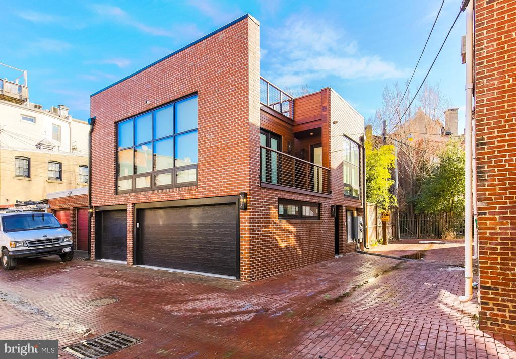 Live in luxury in the heart of Logan Circle.  This tastefully renovated  2 bedroom/2 bathroom carriage house offers a classic charm with modern touches throughout.  Great investment- this was previously rented with $78,000 annual income, which can be reinstated!  Walking in, you will see the spacious and sundrenched living area, with floor-to-ceiling windows and herringbone floors throughout.  Right off the living room, you can open the glass French doors to the perfect balcony. The Chef~s Kitchen is outfitted with a breakfast bar and a suite of stainless steel top-of-the-line appliances. The large Owner~s Suite stuns with designer finishes, a walk-in closet, and access to the balcony. The spa-like bathroom is adorned with double vanities and marble finishes.  The second bedroom features ample closet space and a marble en-suite bathroom. The private roof deck is an oasis in the city, with sweeping DC city views and room to lounge, unwind, entertain, and more!  A masterpiece you won~t want to miss with expert craftsmanship and timeless design. Finally, the location here is key. Logan Circle is complete impressive array of restaurants, boutiques, fitness studios, and grocery stores all within blocks of each other. Welcome home!
