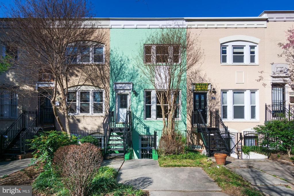 "Open House Sat (3/7) & Sun (3/8) 1-3PM.   Spectacular 1979 3-level Dupont Circle rowhouse w/separate rental ""English Basement"" unit on lower level and off-street parking space in rear alley of home.  Small front yard for lounging, barbecues, etc...  Lots of updates: Andersen replacement windows, new HVAC systems (in both units), brand new roof and skylight,  new iron stairs at front, 2 new water heaters, 2 washer/dryers.   Upper unit (1908) has 2 bedrooms (with tons of closet space), 1.5 baths (full bath was just renovated!), LR w/wood-burning fireplace, separate DR, updated T/S kitchen & new appliances, newly refinished hardwood flooring.   The currently rented lower level unit (1906) has 1 bedroom w/a wall of closets, a full bath, LR/DR w/wood-burning fireplace, a full kitchen (newer appliances), and hardwood floors.  Current tenants are month-to-month for $1,900/rental amount.   Live in one unit and rent the other!!  Relax in the nearby parks and dog parks, dine out at many of the surrounding neighborhood restaurants, plus shopping, gyms and steps away to nightlife!  Close to the Dupont and U Street Metro Stations."