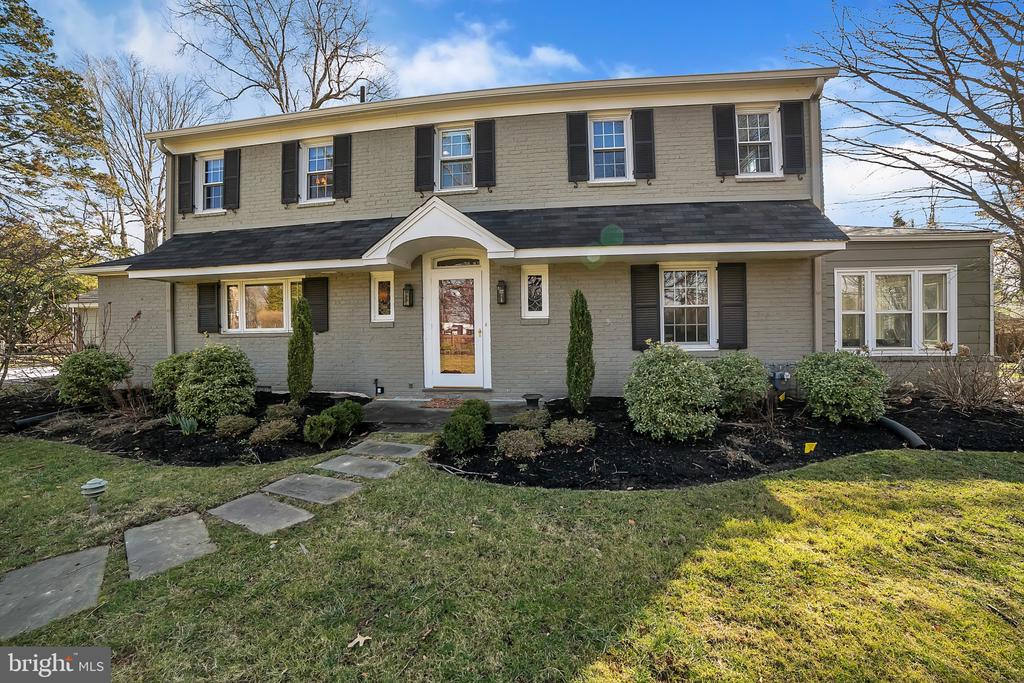 Welcome to 701 Mount Moro Road. This fabulous, move-in ready, brick colonial is located on one of Villanova's most coveted streets. Walk in through a the traditional, straight through entryway that leads to the welcoming, bright living room. The living room features a charming marble surround, wood burning fireplace and French doors that lead to an enclosed side sunroom.  The sunroom provides a great extension of living space that can be enjoyed from the living room or main level den/office and provides easy access to the side yard.  Just off the living room, through the wide cased opening, is the Dining Room.  It features wainscoting, crown molding, floor to ceiling windows and another beautiful set of French doors that lead to an exterior stone terrace with pergola that provides wonderful indoor/ outdoor entertainment.  An open connection from the Dining room to Kitchen continues this relaxed and seamless flow. The recently updated white Kitchen offers dramatic contrast with rich honed soapstone counters, porcelain farm sink and stainless-steel appliances including Liebherr French door refrigeration.  It provides convenient access to driveway and garage.   Second floor offers 4 bedrooms.  The light-filled Master Bedroom features a renovated Master Bath with honed Carrara marble tile on the floors, walls, shower and vanity top. Three additional spacious bedrooms enjoy a renovated hall bath with painted steel vanity, subway tile that goes to the ceiling and inset storage in the shower / tub. Partially finished Lower level is outfitted with additional recreation space, including home theater, play area, storage and laundry. Hardwood floors throughout.  Many improvements including new windows, waterproof basement, main house generator transfer switch, and more.  See full list of improvements.  Classic meets current in this not to be missed home located a short walk to Appleford Estate, and just four turns to the Blue Route and I-76 connections.