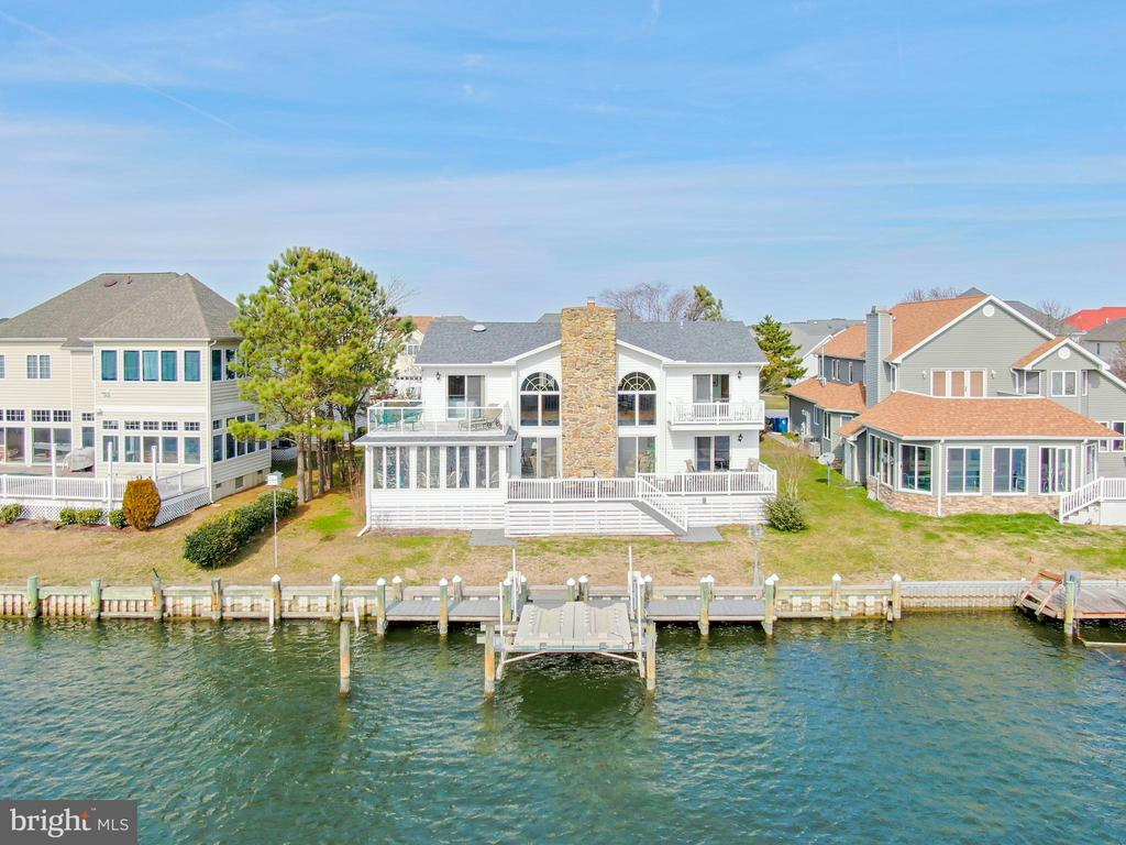 Well crafted five bedroom waterfront in Tern's Landing with OC skyline view from backyard. Living Room contains impressive floor to ceiling fireplace, wet bar and ceramic tile . Main floor also contains a Sunroom , a kitchen with granite countertops, breakfast and desk areas, and a shop area adjacent to garage. The 2nd floor possess large loft area and the rear bedrooms have associated decks. Anderson Windows. Bulkhead is made of long-lasting interlocking plastic paneling. The AHS Complete Option Warranty in effect till 1 Nov 2020. Recently replaced the upper zone Heat Pump . Approximately 40 K invested in property during 2019 after purchase including new roof in December 2019 and Dry Zone encapsulated crawl space in Spring of 2019.