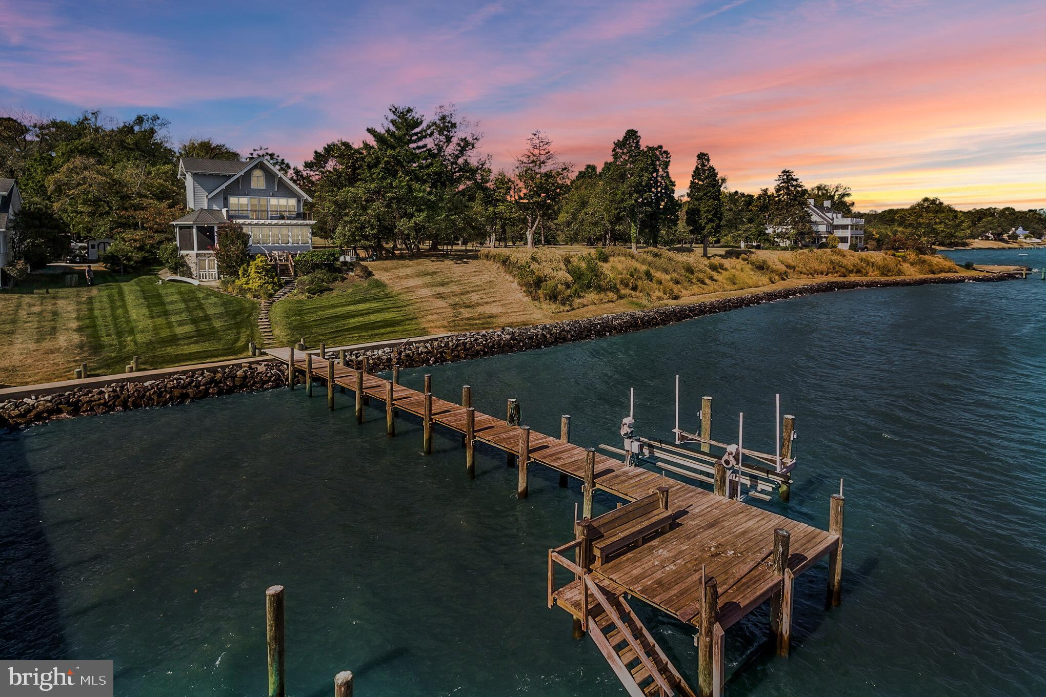Your search is over for the perfect waterfront home!  Gorgeous Chesapeake Bay views with your own private pier and lift. Easy access to the water from flagstone steps.  The house was rebuilt in 2007 with the highest quality standards. Here you will have the main level with gorgeous kitchen and walk in butlers pantry, formal dining room, a library/bedroom with full bath next door and magnificent living room and sunroom all with Spectacular Bay Views! Huge deck off the living room and private screened porch allow you enjoy the bay breezes throughout the year. Upstairs you have a wide staircase to ascend to the bedroom level with 3 bedrooms, full bath with steam shower and master suite and beautifully appointed master bath. One bedroom has it's own private deck for out of this world views. Striking architectural details are seen from the decks along with architectural shingles, wood trim and Hardy Plank siding. Go up another level with still more views from lots of windows to the bonus room which is lined with cedar closets for storage. Unlike most waterfront homes, here you have a full unfinished basement for storage of your watercraft and household items. It is a walk out to the steps down to the pier. So many upgrades are found in this beautiful home including, irrigation, extra lot was purchased giving you more land and frontage with no easements. All the floors are heated with radiant heat , steam showers, jacuzzi tubs, skylights, wood floors, walk in pantry, pocket doors, built in book shelves, kitchen features wine cooler, espresso maker, double ovens, 6 burner propane stove, prep sink and large deep stainless sink, utility room with sink and extra refrigerator, 2 generators, water softener, UV light and reverse osmosis, Weather resistant Anderson windows and so much more! So much charm, so many unobstructed views, only 12 years new and situated next to a very large parcel of land with the only house far, far away from yours. Privacy and Bay Frontage are very ha