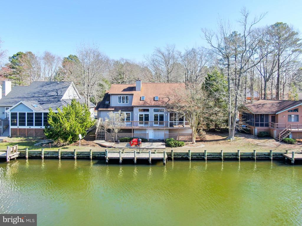 Direct River Access from this Sunny & Bright Waterfront with LOTS of Windows and Skylights!  Soak up the Sun on the rear multi-level decks, screened porch or on your private Boat Dock! New carpet, vinyl & fresh paint. Laminate Flooring in Living, Dining & Master Bedroom. Upstairs Loft overlooks the Entry and the living areas.  Dual-Zone Heat Pumps replaced in 2013 & 2017.  Roof replaced in 2004.   Attached storage shed in rear, Plus more storage in extra-high crawl space under rear porch and deck. One Year Cinch/HMS Warranty included to Buyer.  Enjoy Waterfront Living in Award-Winning Ocean Pines!
