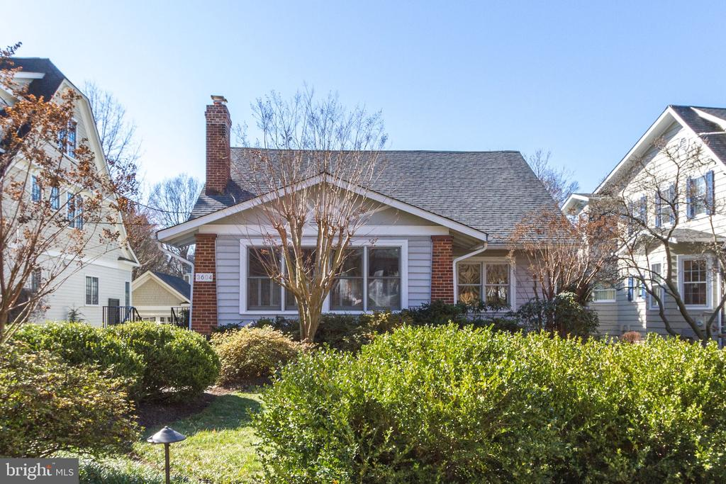 Open House Saturday 1-3pm and Sunday 1-3pm.  Tastefully designed and renovated, this expanded 1925 Bungalow in sought-after Village of Chevy Chase, Section 5 awaits its new owner.  The main level has a spacious foyer with a large coat closet and gracious living and dining rooms. The remodeled kitchen opens to a light-filled family room with cathedral ceilings.  In addition, a large mudroom with bench storage is ideally located out of view from the adjacent kitchen and family room.  Two main level bedrooms and a remodeled full bathroom complete the first level. The second level offers a large master bedroom and dressing room with custom built-in closet shelving and ample hanging space. A remodeled master bathroom with two pedestal sinks, soaking tub and walk-in shower adds to this well designed master bedroom suite.  A fourth bedroom with fabulous windows completes the second level.  This home also offers a large finished lower level with office, two walk-in closets, a playroom or guest suite and third full bathroom.  The adjacent laundry and utility room provides another storage area.  Enjoy the privacy of a professionally landscaped backyard and patio.  A large detached garage with rubberized flooring has additional attic storage with pull down stair access.  In addition to offering approximately 3200 sq.ft. finished living space, 9'+ ceilings, custom plantation shutters and hardwood floors, this home is walking distance to restaurants, shops, neighborhood parks, playgrounds and weekend farmers market.