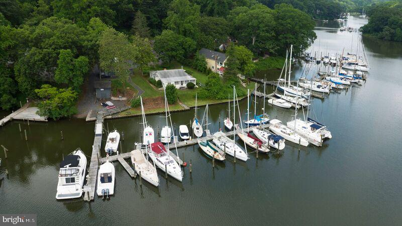 Mill Creek Waterfront Opportunity with fully leased 17 slip marina. Property offers, State of the art floating dock, new electric service and water. Two new nitrogen septic systems and two new wells with water treatment system. Lot is .71 acres with a new bath house with shower and garage/work shop. Separate Marina office with storage below. There is a matt system under all the parking and driveway that supports heavy equipment. There is the ability to run a commercial repair business on the property as part of the continued non-conforming status. Existing house can be renovated or a new 3500 sf home can be built in its place. Permits can be renewed for the redevelopment. Owner will consider a build to suit.