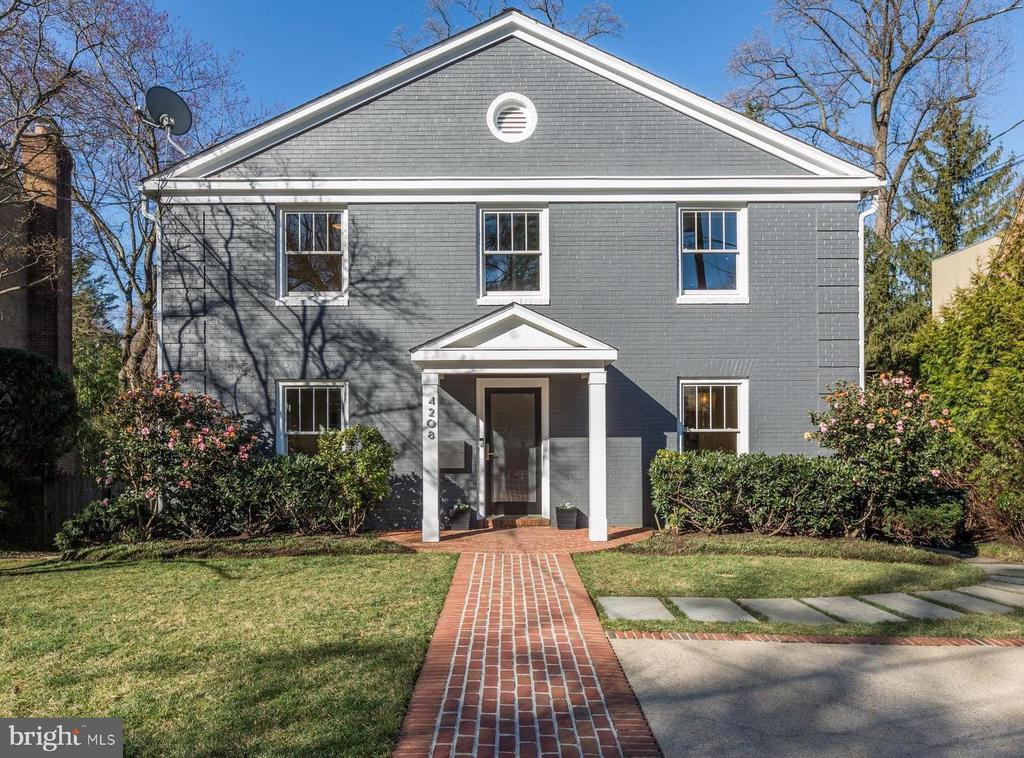 This contemporary updated five bedroom, three and a half bath, colonial sits on a quiet cul-de-sac in the Town of Chevy Chase and is light-filled with updates and high-end finishes throughout. The main level has a separate living room and dining room with hardwood floors and oversized windows, a renovated half bathroom, and an updated, open-concept kitchen and family room with deck. Upstairs, the master bedroom has a dressing room with custom shelving and an updated ensuite bath with double vanities, a soaking tub and separate shower. Three additional spacious bedrooms are on the upper level with ample closets in addition to another full bathroom. The light-filled walkout lower level boasts a large recreation room that extends outside to the patio. In addition to the recreation room, the lower level includes a fifth bedroom, au pair suite, or office with an exterior door, a full bathroom, and bonus room. Rounding out this gorgeous all brick home, is the expansive rear deck, patio and backyard ideal for private outdoor entertaining. The home is minutes away from the Red Line metro, Capital Crescent trail, and vibrant downtown Bethesda with plenty of shopping and dining options. Listing agent is owner.