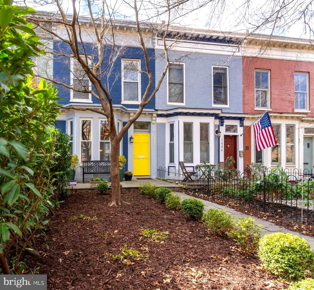 **JUST LISTED!**Originally built in 1870 and uniquely sited on one of Logan Circle's most quaint blocks with an extraordinarily deep setback from Historic T Street, NW.  This charismatic, 2 bedroom / 2.5 bath property has been thoughtfully renovated by its current owners to include all of the modern amenities, while preserving many original Historic details. Spectacular, open floor-plan with bayfront window overlooking a lovely flagstone terrace & deep garden; sun-filled Southern exposures and fully enclosed private brick terrace, garden & gated parking at the rear of the property. Additional features include original, gleaming Heart of Pine hardwood floors, wood burning fireplace, and partially finished lower level with potential for additional bedroom and/or den.  This rare offering provides a serene urban oasis in the middle of vibrant Logan Circle, with an abundance of shopping, dining & nightlife options at your doorstep.