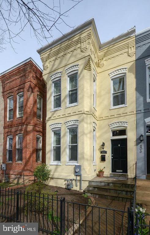 Only one block to the THRIVING heart of the H Street Renaissance, you can live at the center of city convenience and simultaneously savor a serene residential streetscape! Renowned local developer Nantucket Holdings completed a top-to-bottom and front-to-back expansion and renovation of this Victorian bay-front, featuring new floors, walls, wiring, plumbing, windows, plus exposed and refinished century-old brick walls. Owners' BR and en suite bath and three REAL BRs with roomy dimensions on second level. BONUS: Rear extension for flexible den, home office, or sun room. Outside, private flagstone patio for shady Summer gatherings, plus secured parking for two cars beyond.