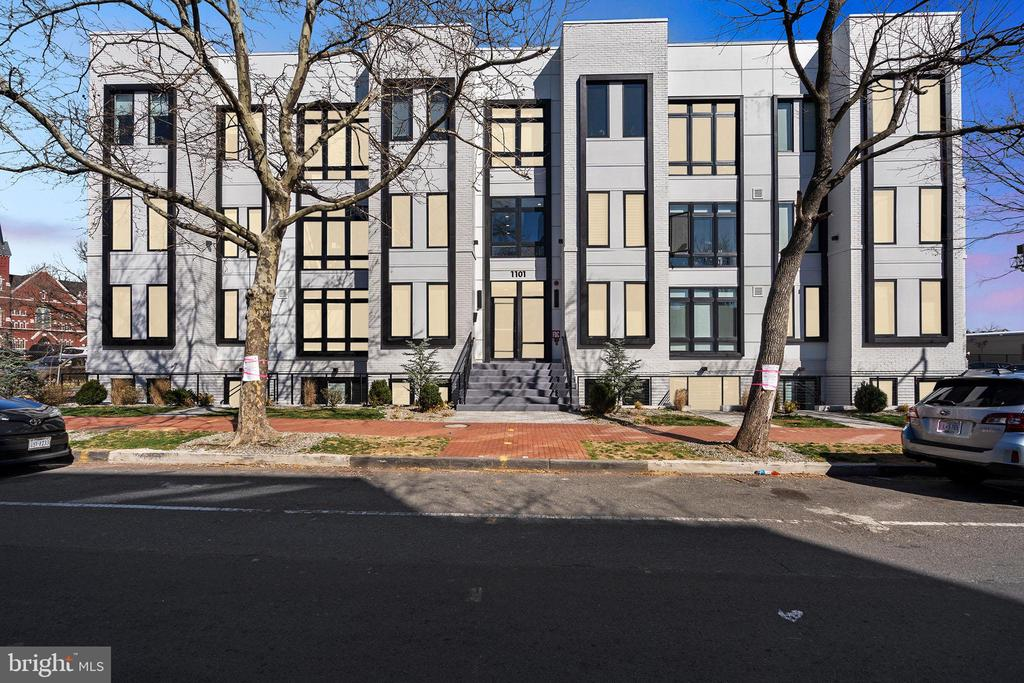 ***JUST LISTED.  OPEN SAT, 3/14, 1-3 & SUN, 3/15, 1-4***   Unit 302 offers the best combination of new AND improved at 11 Q.  First sold in 2019, this gorgeous unit has barely been lived in.  The sophisticated finishes still sparkle like new, and the home has recently been improved by the addition of custom Elfa closet systems, sophisticated window treatments and elegant lighting fixtures throughout.  One of the unit's most jaw-dropping features is its expansive outdoor terrace right off the living room, offering over 200 square feet of uncommon outdoor living/dining space.  (It's not a distant rooftop deck but rather the kind of outdoor space YOU'LL ACTUALLY USE!)  Inside the unit, you'll enjoy a chef's kitchen with Bosch appliances, 5-burner gas cooktop, Porcelanosa cabinets and spa-inspired baths, wide plank oak floors throughout, ample closets and TWO extra storage units in the lower level of the building.  With high ceilings, an expansive kitchen island and walls of windows letting in tons of natural light, this is an entertainer's dream home--a place you'll be happy to be!  And given the location at the intersection of Logan Circle, Shaw, U Street, Bloomingdale and Downtown DC, it's no surprise that this home boasts a Walk Score of 97!  Don't miss it!