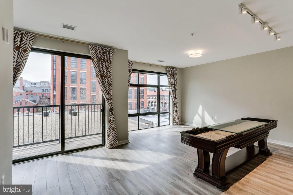 "This must see, bright condo features high end design, custom closets, in unit washer/dryer,  massive south facing windows, and private balcony! This unit has a neat alcove for a reading nook or separate office area, as well as a shuffleboard table with top used as a kitchen island  - fun and functional!       Incredible location!! Located in NOMA,  within 1.5 blocks from the H Street Corridor and *Half of a mile* access to UNION STATION, Whole Food, Bus/ Tram stops, and much more! Pullman Place is an amazing building that offers a fitness facility, dry cleaning pick up, and rooftop terrace with beautiful skyline views!  Ask about potential parking availability.   96 ""Walk Score"" !!  **Check out the 3D VIRTUAL TOUR!**"
