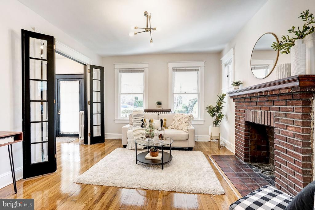 For the first time in 72 years this home is available for its next owners! 1020 Newton is a historic stunner exuding original detailing from the glass and brass door handles to original millwork and wood flooring. Located just steps from all that 12th Street NE has to offer and minutes from the Brookland Metro Station. The large front porch welcomes through the front door into a charming foyer. The first floor maintains the living and dining rooms, kitchen, full bath and a rear flexible space perfect for a second living room. Five bedrooms, a den and a full bathroom are on the second floor with access to the unfinished attic. The lower level of this home is a fully rentable two bedroom one bath apartment with walk out to the rear of the home. While there is ample off street parking via a private driveway and detached garage, there is also the ability for alley access in the rear of the 7,000 sqf lot. The home is conveniently located within a 2 minute walk to the Brookland Metro (red line) and Monroe market with Starbucks, Busboys and Poets,  and tons of dining options along 12th street.